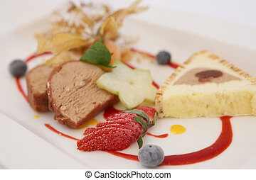 Dessert with Strawberrys and Blueberrys on a white Plate - ...