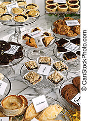 Desserts in bakery window - Various desserts on display in...