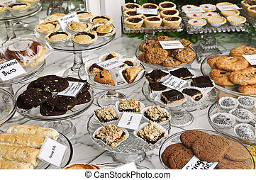 Desserts in bakery window - Various desserts on display in ...