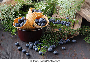 Desserts with fresh blueberries on wooden table