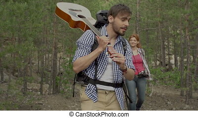 Destination Unknown - Bearded guy with guitar approaching...