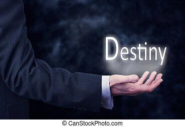 Destiny - A businessmans hand holding the word, Destiny.
