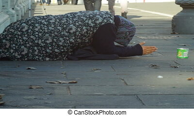Destitute Woman Begging Outdoors