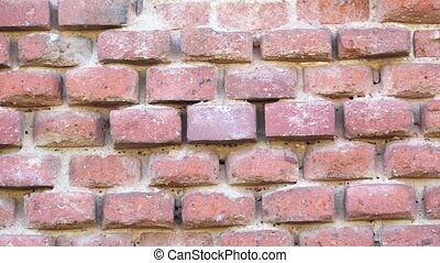 Destroyed brick wall. Old red brick wall.