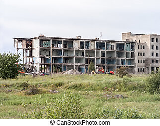 Destroyed building with pile of debris