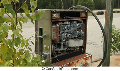 Destroyed gas pump. Car passes. - Destroyed gas pump at...