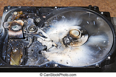 destroyed hard drive - melted hard drive in close up view