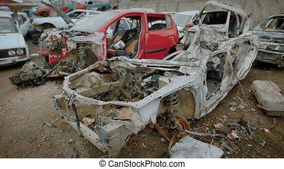 Destroyed rusty car on junkyard - Damaged metal car frame...