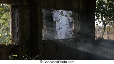 destroyed windows in an old building as well as smoke and...