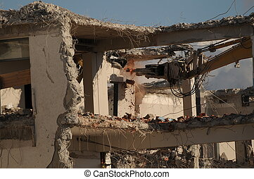 Destroying of an old house by a machine.