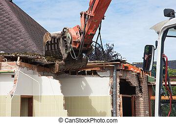 Destruction of a building by a caterpillar crane