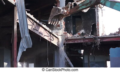 Destruction of Building - Close up shot of a heavy equipment...