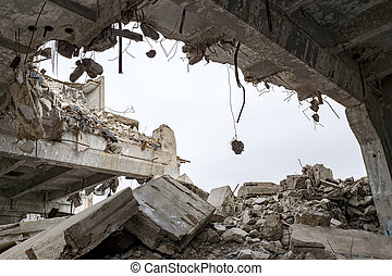 Destruction of buildings. A huge gap in the concrete slab with concrete fragments hanging on the rebar. Background