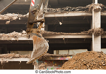 Destruction of concrete building with equipment