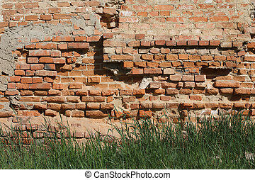 destruction of the old brick wall
