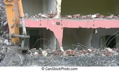 destruction - bulldozer working at a demolition site
