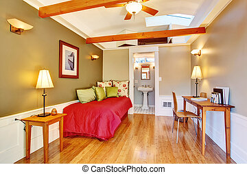 Small bedroom interior with ceiling beams and single bed