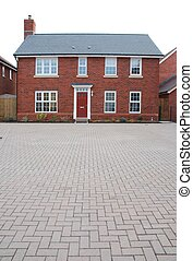 Detached red brick house