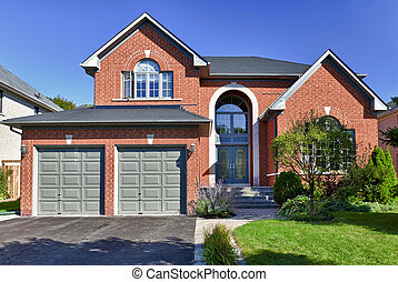 Brick house in suburbs with two car garage
