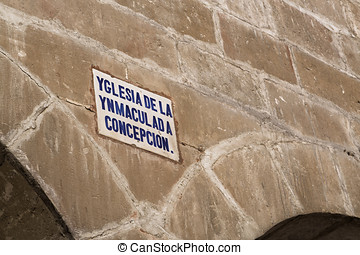 Detail architectural and sign of the street name written in old Castilian, Arch of limestone, Baeza,  Jaen province, Andalucia, Spain