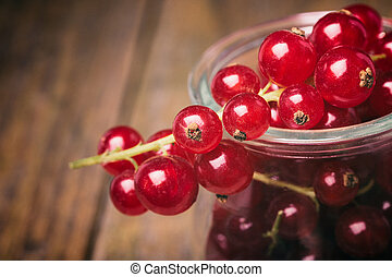 Detail bunch of red currants in a glass cup. Healthy fruit ...