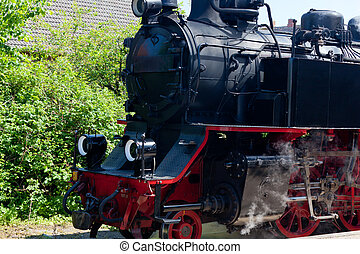 Detail detailed photo of a historic steam locomotive in Baltic Sea resort Kuehlungsborn