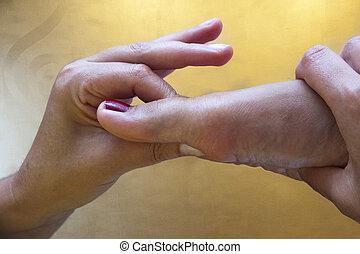 Detail foot reflexology massage - Therapist is practicing ...