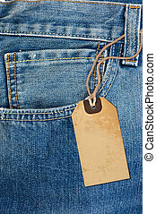 Detail from a jeans and his tag label Details from blue jeans Detail from a jeans