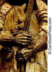 Detail knight armor. Gloves and sword of a knight.