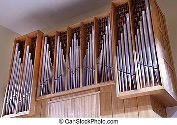 Detail look of large pipe organ; rows of beautiful metal pipes