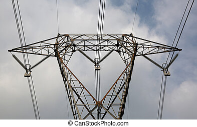 detail of a big pylon with very long electric wires