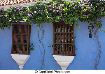 Detail of a colonial house. window & wall in blue