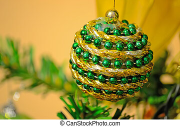 green and gold Christmas ball