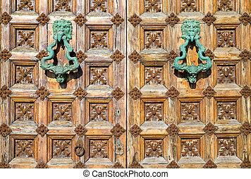 Detail of a medieval door seen in Sitges, Spain