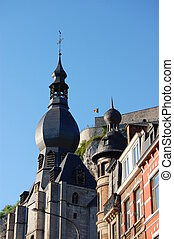 Detail of a old architecture church tower and castle behind...
