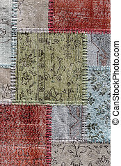 Detail of a old patchwork carpet