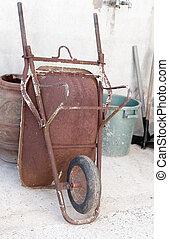detail of a old wheelbarrow