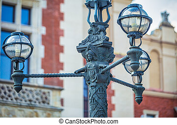 Detail of a street lamp in the historic center of Krakow town, P