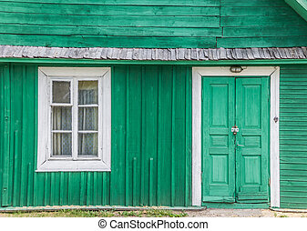 Detail of a traditional green wooden house in Trakai, ...