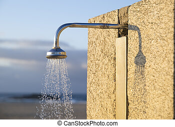 Detail of a water shower on the beach in horizontal composition