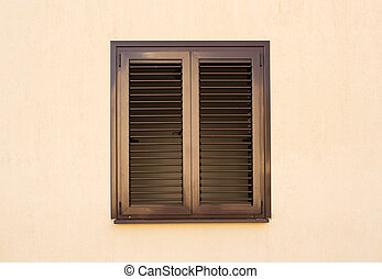 Detail of a window with shutters closed
