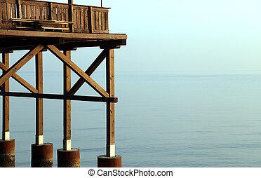 detail of a wooden stilt house on the seashore