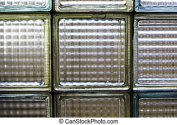 detail of a yellow and blue glass brick window.
