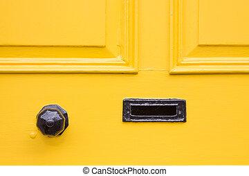 Detail of a yellow front door