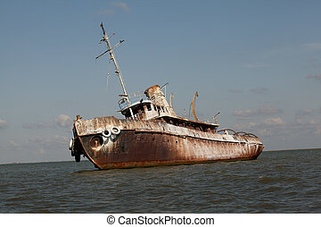 detail of abandoned wrecked ship, seaside landscape - side ...