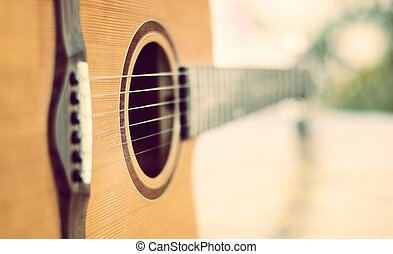 detail of acoustic guitar with shallow depth of field