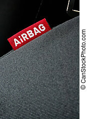 Detail of an airbag label on the side of a car seat