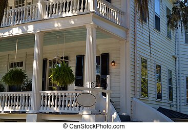 Front porch detail of a southern Antebellum house in South Carolina low country.