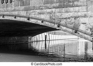 detail of an old berlin stone bridge in black an white