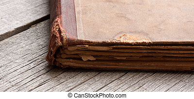 Detail of an old book on a wooden table